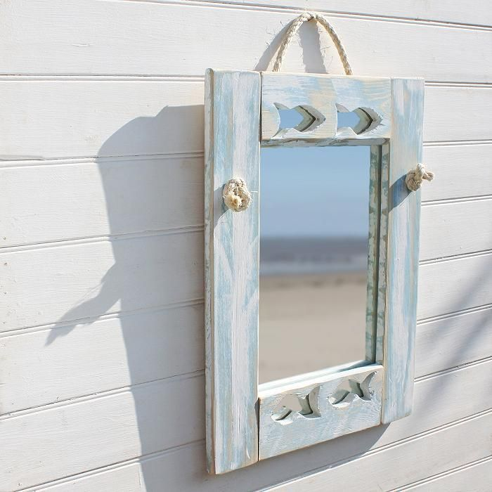 This coastal inspired fish mirror really captures the feel of the sea. Each handmade wall mirror has been painted and then distressed back to reveal the duck egg blue shade beneath.