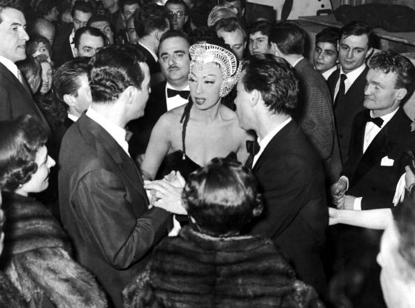 Josephine Baker in the 1940s surrounded by admirers