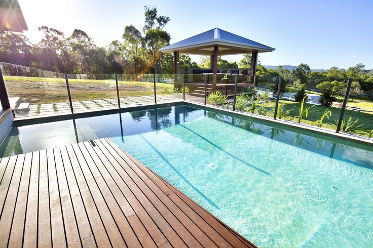 Wooden decking and gorgeous swimming pool make for perfect outdoor living.