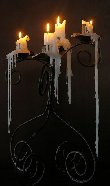 ~purchase a large floor candelabra  ~place it inside a large silver tray  ~use candles that drip wax lavishly  ~allow to continue accumulate   ~it will become a wax sculpture