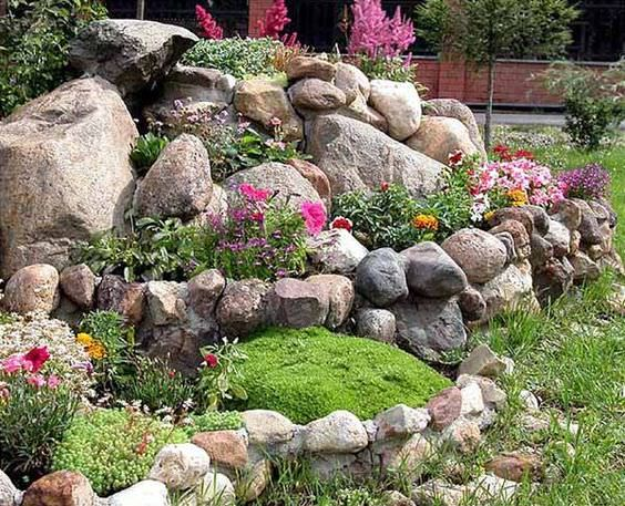 Essential tips to landscape design with rocks and layout of stones. How to choose the right stone & plant and other steps in our full tutorial guide.