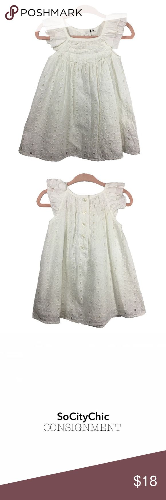 MARKS & SPENCER EYELET DRESS MARKS & SPENCER EYELET DRESS. SLEEVELESS WITH RUFFLE DETAIL. CIRCULAR EYELET DETAIL. CENTER BACK BUTTON UP CLOSURE. FABRIC: COTTON. CONDITION: NWTS. SIZE 3-6M. MARKS & SPENCER Dresses Casual