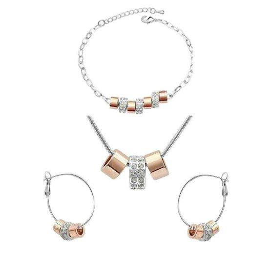 A gorgeous Necklace, Earrings and Bracelet set. White Gold Plated, adorned with copper and shinning Crystal. A stunning fashion jewelry set that will no doubt p