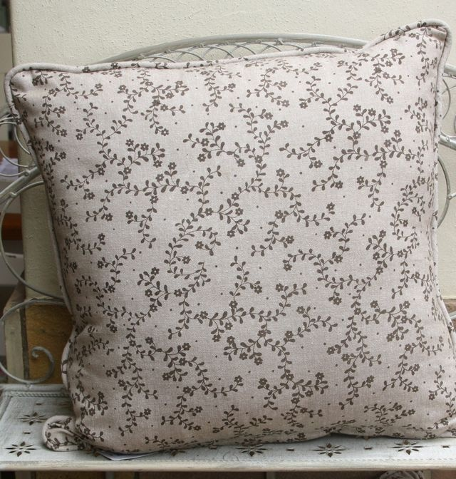 Beige cutlery motif cushions. These cushions are double sided with floral detail on reverse. Available in two sizes: 45cm x 45cm & 35cm x 50cm