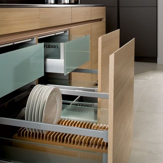 The two-in-one plate drawer from Leicht combines a soft-close, handleless drawer with plate storage below and a separate cutlery drawer above.