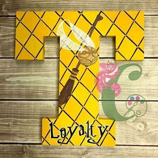"""Loyalty. A strong Characteristic of the Hufflepuff House. Gosh that's fun to say. Hufflepuff. Omg! If I ever get a pug I'm gonna name it """"something"""" Hufflepug. 🤣🤣🤣🤣. Ok, really.... this is the first of 9 Harry Potter letters you will be seeing over the next few days. Sebastian I swear your name is coming!!!!!! #colorfulcharacters #paintedletters #woodletters #handcut #handpainted #handcrafted #potterhead #hufflepuff #quidditch #sebastian #characterletters #t #loyalty #iswearimalmostdone…"""
