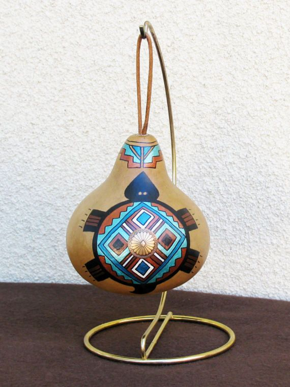Hand-painted large gourd ornament with a turtle motif.  Approx. Measurement: 4.5 H x 4 W  Painted in rich earth tone colors, embellished with a concho button and featuring different front and back designs (as seen in the photos), this large gourd makes quite a statement. I painted the Southwest petroglyph-inspired turtle and the geometric design using matte and metallic colored acrylic paints. A satin cord is attached to the top for hanging on a tree branch or a display stand. Fortunately…
