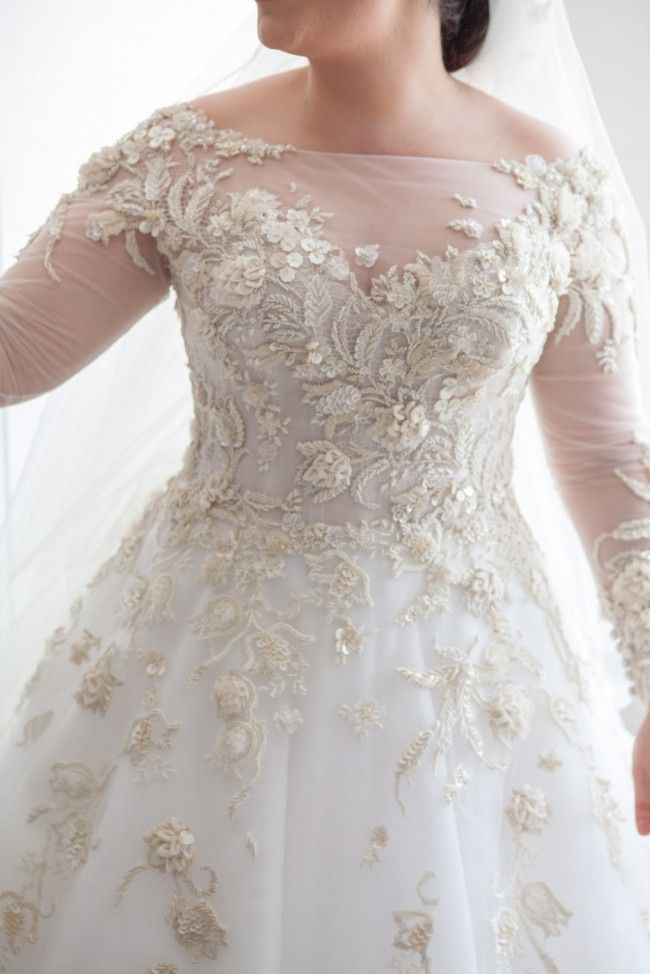 Long sleeve plus size wedding dresses for the modest bride with curves. An ornately embellished bridal gown with long sheer sleeves to cover the arms. Discover other long sleeve plus size wedding dresses at http://www.dariuscordell.com/featured_item/custom-wedding-dresses-custom-bridal-gowns/ (replicas of couture pieces and custom designs are an option) #slimmingbodyshapers   Look stunning in your wedding dress with the help of plus size shapewear and bras slimmingbodyshapers.com