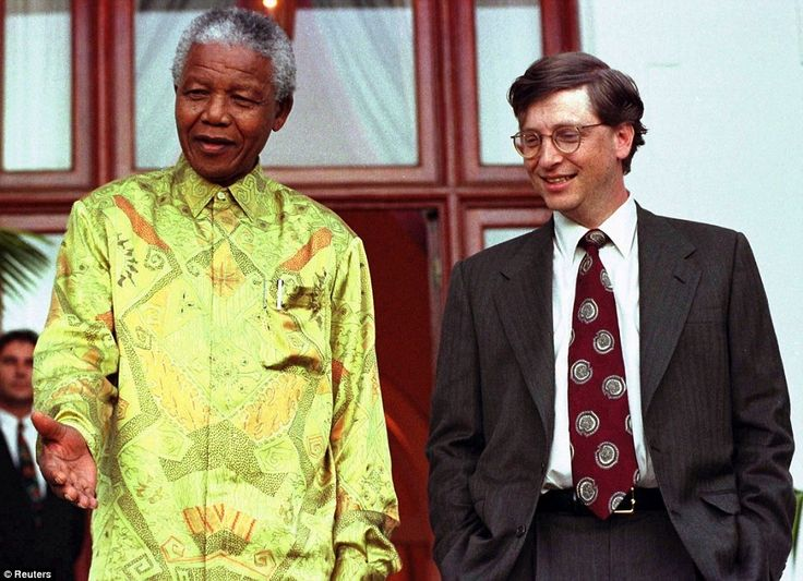 Leader and philanthropist: South African President Nelson Mandela (L) shares a joke with Microsoft Chairman Bill Gates after their meeting at Mandela's residence in Cape Town, in this file picture taken March 11, 1997.