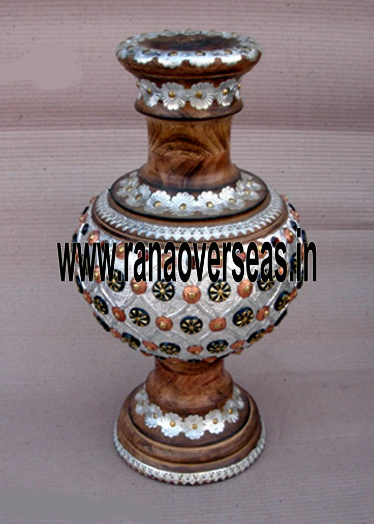 Wooden flower vases / pots serve as decorative pieces specially used to display the plants and flowers together with a beautiful view of exotic flower colors and plant greenery. Our Wooden flower vases are serve as a memorable gifts for near and dear ones. They are ideally placed on writing tables, coffee tables, dining tables, center tables, Room corners, corner racks, corner tables, showcases etc. and impart a touch of style to the decor. The exotic beauty of Wooden flower vases gets