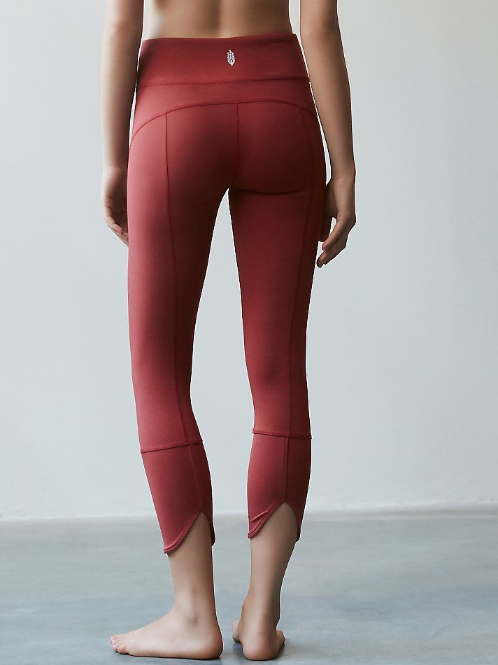 Virgo Legging | Activewear leggings in a performance stretch fabric. Features a banded waistband and slit back hem.