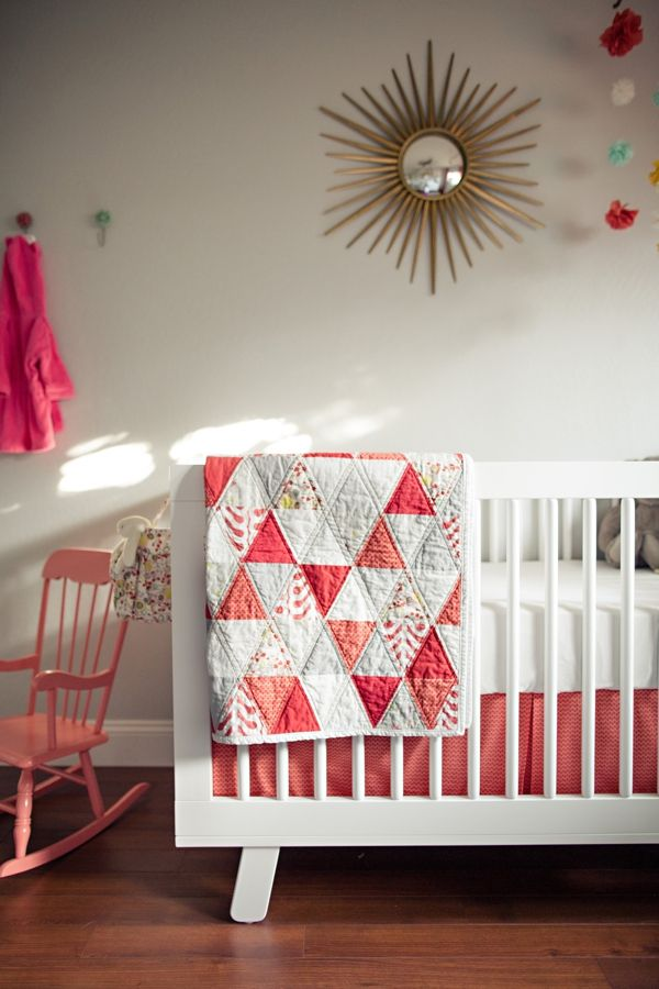 I like the quilt pattern! Think living room throw in coral and navy.