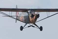Piper J-3 Cub painted to represent an RAF L-4 approaching Compton Abbas airfield.