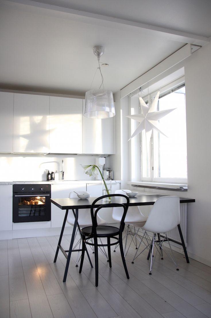 Homevialaura | Modern White kitchen | Kartell Gé | Eames DSR | Ton Chair 14 | Anno Paperitähti from Kodin1