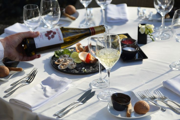 Refreshing Greek white wine is the best choice to accompany your seafood.