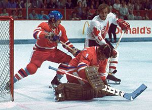 Czechoslovakia's Vladimir Dzurilla makes the save while Vladimir Martinec keeps close watch on Canada's Guy Lafleur during Game 2 of the 1976 Canada Cup best of three series.