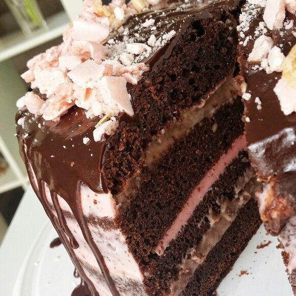 Chocolate cake with pastry cream, raspberry buttercream and dark chocolate ganache