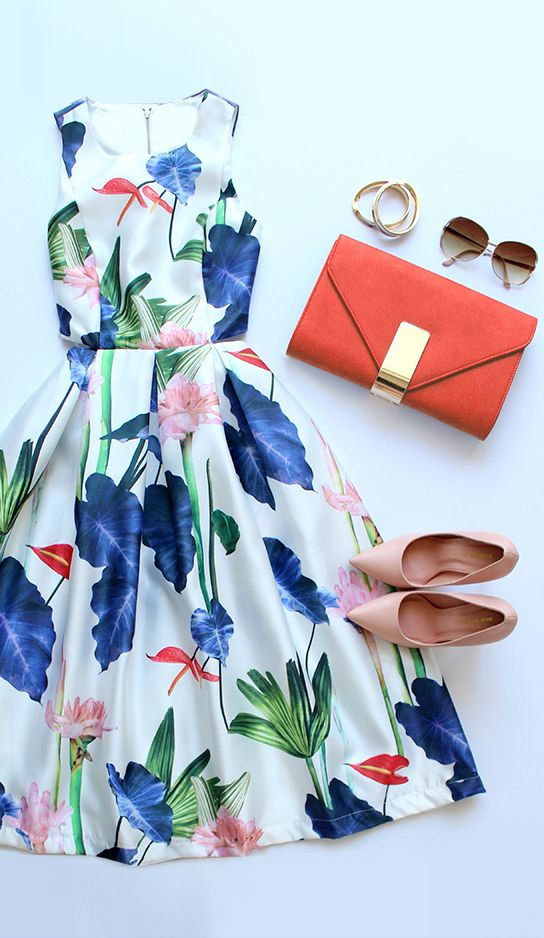floral midi dress with nude pumps and orange clutch. great summer wedding guest attire