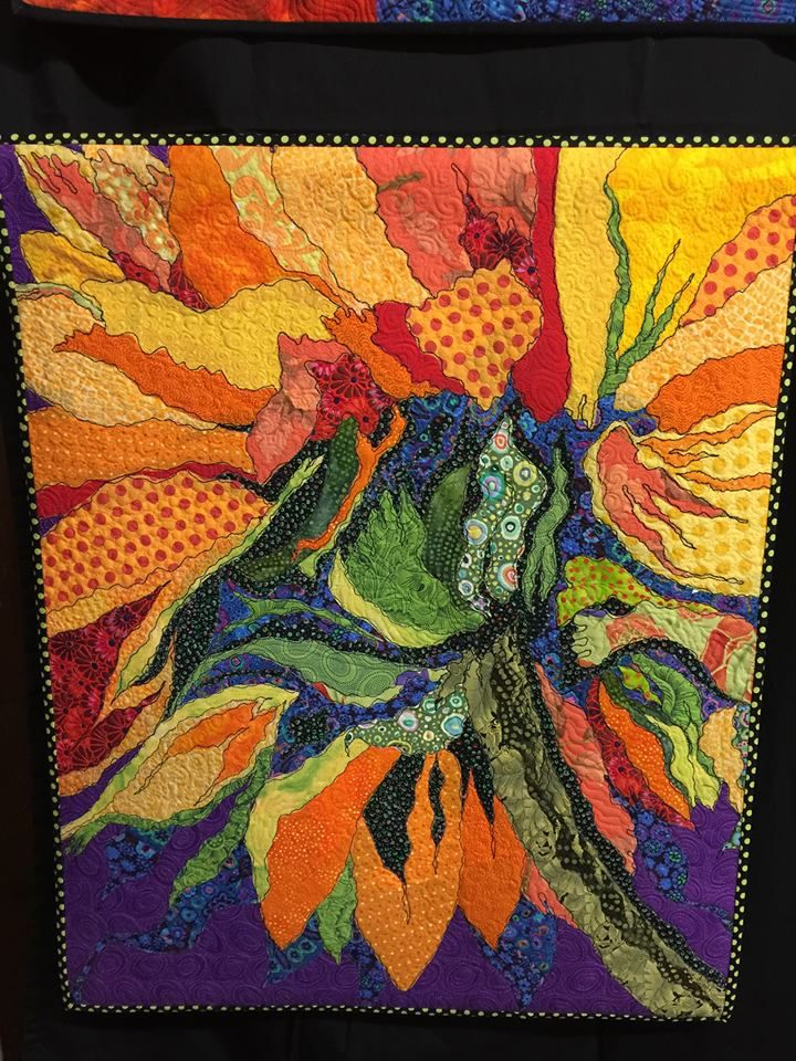 by Donna Greenwald. I like the variety of fabrics and prints used in th ese petals.