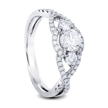 White gold diamond engagement ring trilogy look with round centre diamonds