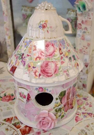 Beautiful Mosaic Shabby Chic Bird House. I love the idea of using a vintage teacup on the top with the pearls. There is not a link to this but the photo looks pretty easy to follow.