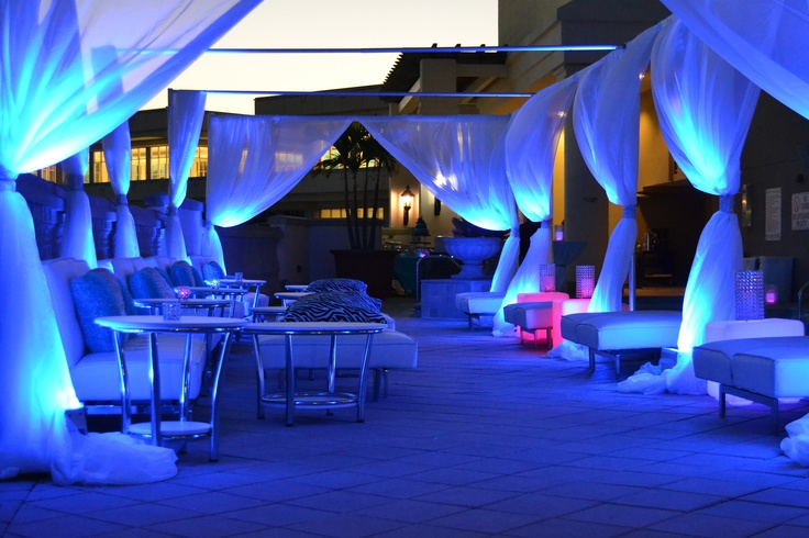 Miami Themed Rooftop Party- Lounge area with couches, tables, LED up-lighting and draping.