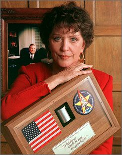 """Majel Barrett Roddenberry, seen here holding the ashes  of her husband, Star Trek creator Gene, died on Dec. 18.  Her remains and the rest of his will be launched into space next year. James """"Scottie"""" Doohan received the same treatment in 2007."""
