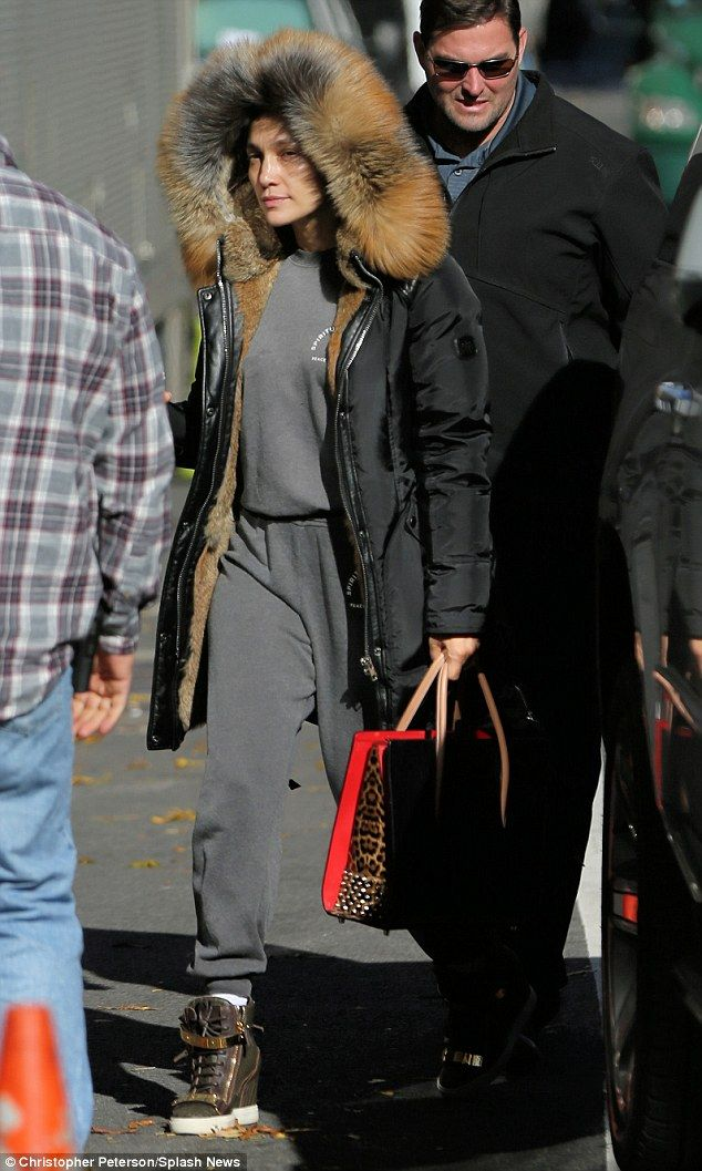 Au naturel: Jennifer Lopez showed off her youthful looks as she arrived on the set of her detective series Shades of Blue in New York on Friday