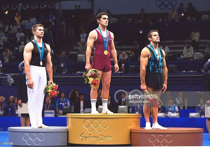 Igors Vihrovs of Latvia (centre) wins Gold, Alexei Nemov of Russia (left) wins Silver and Iordan Iovtchev of Bulgaria (right) wins Bronze in the Final of the Floor Exercise at the Sydney Superdome on Day Nine of the Sydney 2000 Olympic Games in Sydney, Australia. \ Mandatory Credit: Jed Jacobsohn /Allsport