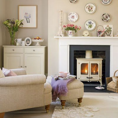 white wood burning stove, love this. I want one in our house...maybe on our far left wall...with an antique mantel framing it.