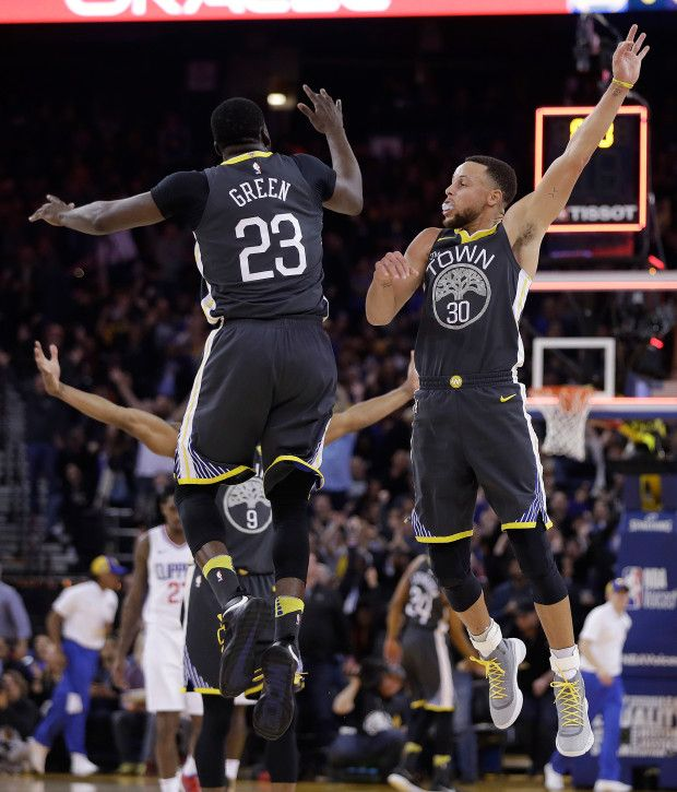 Golden State Warriors' Stephen Curry (30) celebrates with Draymond Green (23) after Curry hit a 3-pointer at the buzzer during the first quarter of an NBA basketball game against the Los Angeles Clippers on Thursday, Feb. 22, 2018, in Oakland, Calif. (AP Photo/Marcio Jose Sanchez)