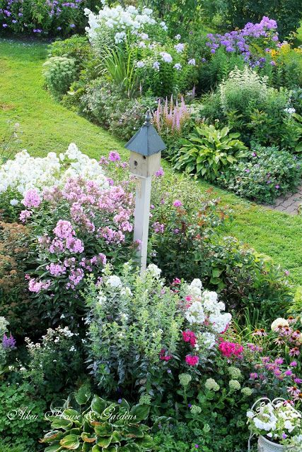 Charming garden landscaping and design ideas by Aiken House Gardens
