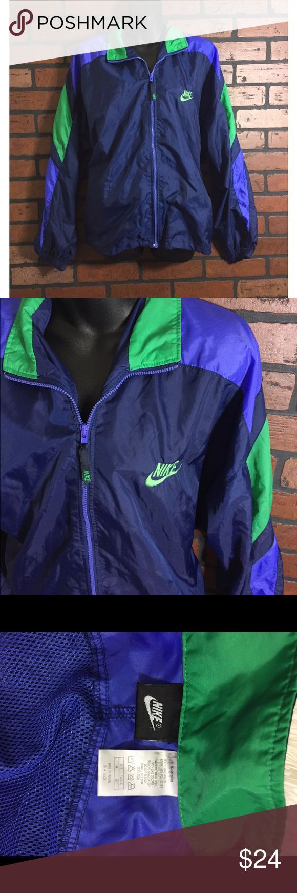 Vintage Nike Windbreaker Men's size medium, or fits women's large! Nike windbreaker. Has minor wear (shown in photo) but in overall good condition! Has two pockets that zip on the sides. Awesome jacket! Nike Jackets & Coats Windbreakers