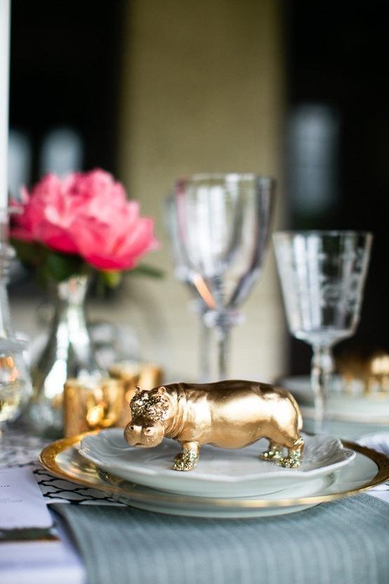 Animal themed escort cards. Plastic animals spray painted gold