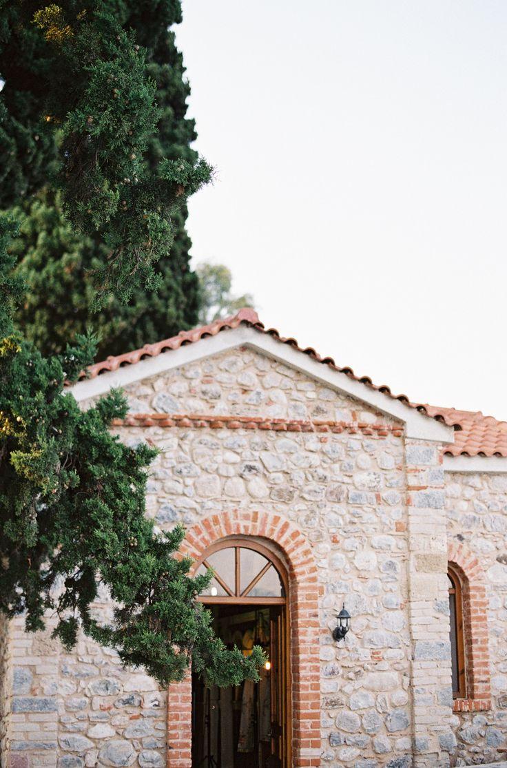 Irini and Stamatis' Elegant Coastal Greek Wedding - gorgeous exterior shot of the ceremony location | fine art film destination wedding photographers + greek wedding photographer Les Anagnou