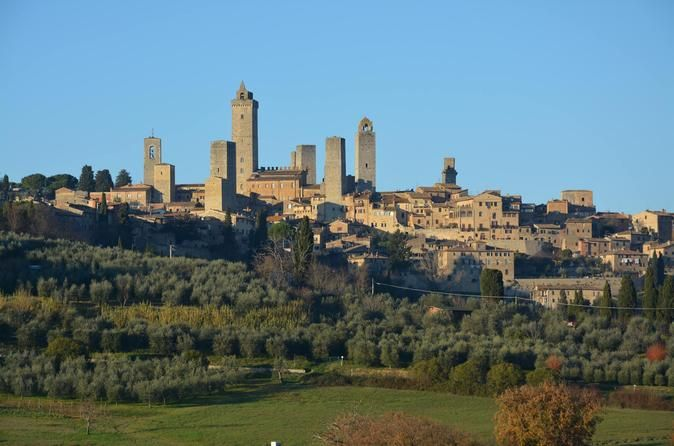 One Way Private Transfer: Florence to Rome with Visit to San Gimignano and Siena Private transfer with English speaking driver by deluxe Mercedes minivan from Florence to Rome or to Fiumicino airport with one hour stop in San Gimignano and Siena on the way.  An english speaking driver will pick you up at your centrally located accommodation in Florence to drive you to Rome or Fiumicino airport. On the way, He will drive you to visit some of the most charming villa...