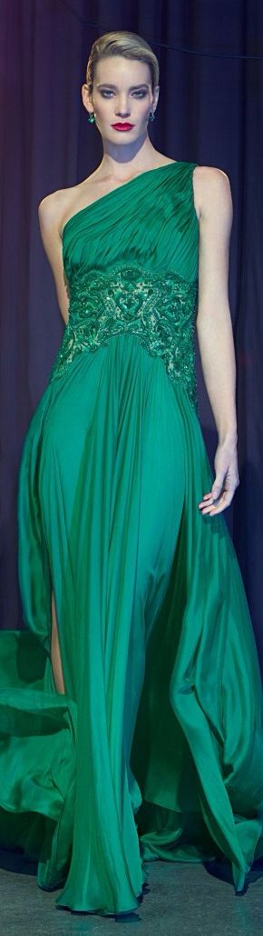 Teal green gown with Grecian influence and a great deal of draping