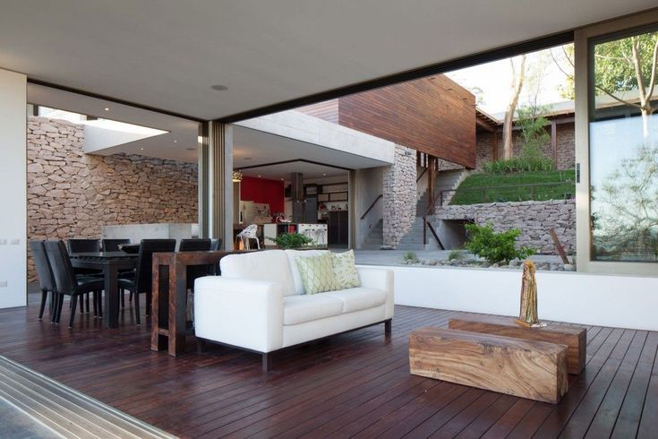 Breezy and beautiful interiors of the home are constantly connected with the central garden