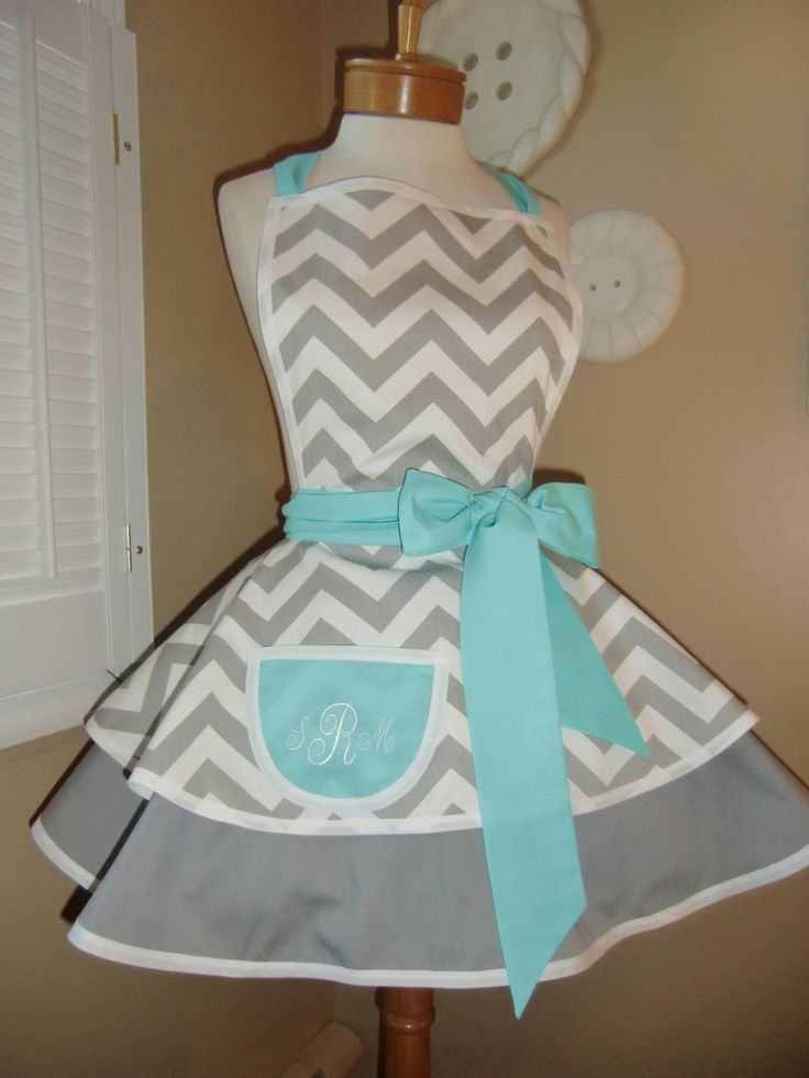 Chevron Print Accented with Aqua Blue Womans Retro Apron With Tiered Skirt And Bib, Featuring Monogrammed Pocket. $55.00, via Etsy.