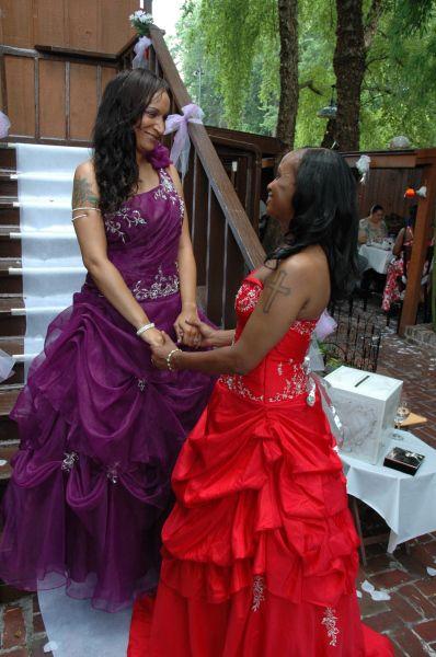 Lesbian wedding; red gown & purple gown #qwocwedding #nonwhiteweddingdress