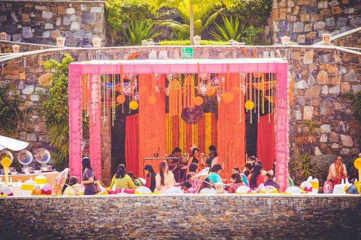 Colourful flowers and ethnic decor for mehndi. #MehndiDecor, #FlowerDecor, #UniqueDecorIdeas, #DayDecor, #ThemeDecor