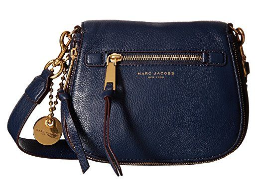 LOVE this Marc Jacobs Cross Body bag in navy blue that is made from 100% cow leather.  This bag features one main compartment with a zip around compartment for storing smaller items.  The interior is lined with the brand name embossed on the front of this bag.