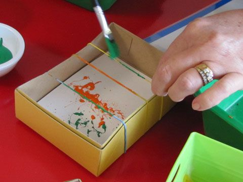 snap painting, paint the rubber bands and then start creating with a snap :)