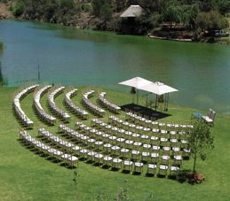 Ceremony on lawn overlooking the dam