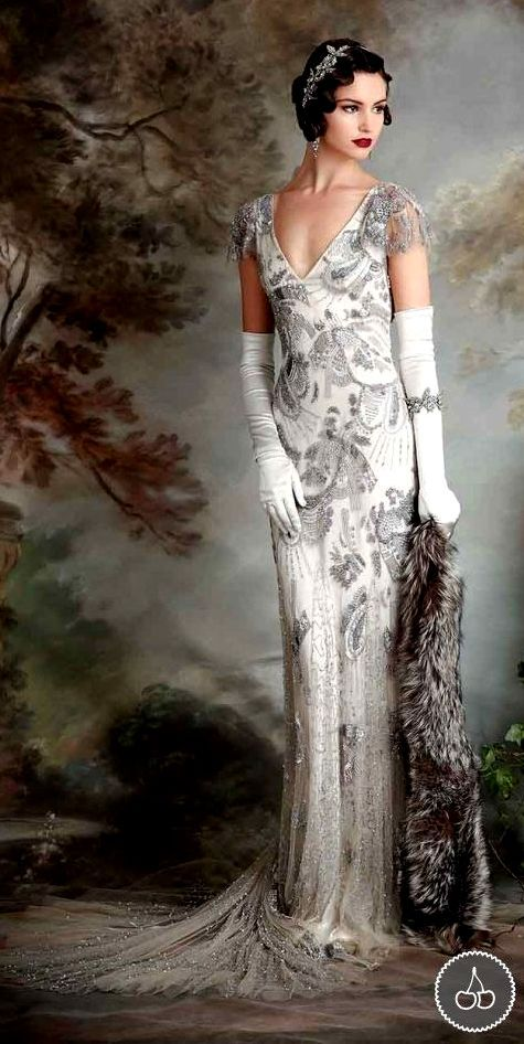 I'm just crazy about this look! Go vintage at http://www.thevintagelighthouse.com/ Beautiful silver/grey-printed 1920's wedding dress