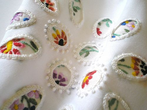 This is gorgeous! Small  bordered pictures that look like snippits cut out of other pieces-I am pinning this to remember to find more info on this designer...Karen Ruane.  I love this!