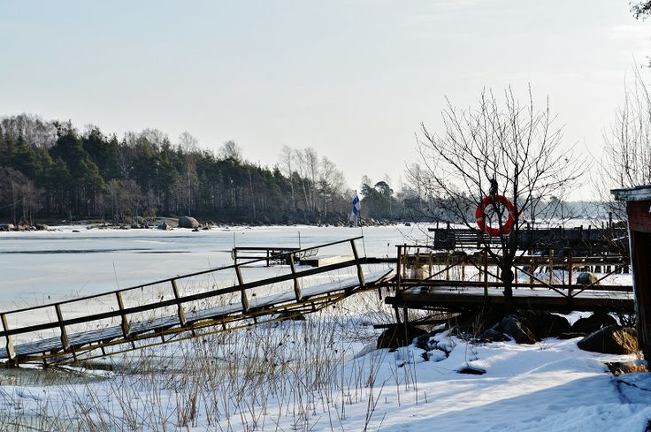 Winter dock and the frozen sea in Tiutinen, Finaland