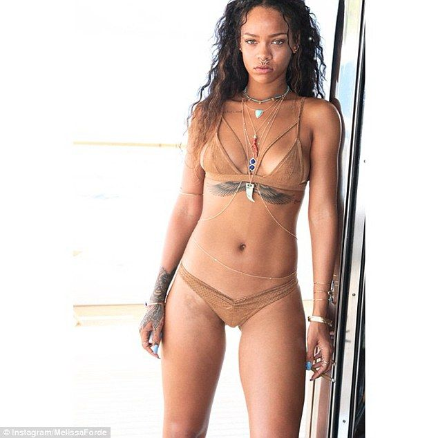 Flawless: Rihanna showcased her incredible curves in a tan tribal bikini via Instagram on Wednesday afternoon
