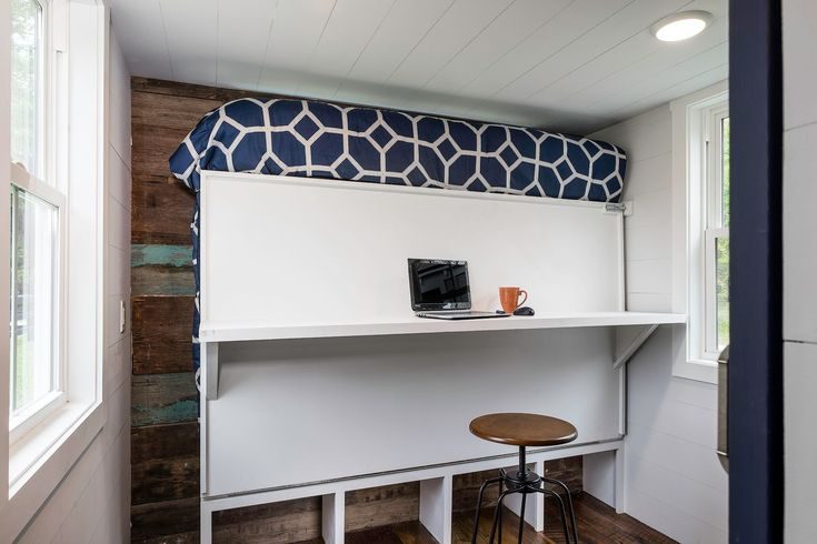 Murphy bed converts to office with built in desk