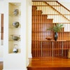 Unique Banister-This grid functions as an unconventional banister and a wall separating the room from the stairway. Reedy balusters and a curving rail keep the feel of the piece light, despite its size.: Trimwork, Home Improvement